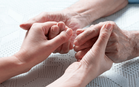 holding hands with a senior